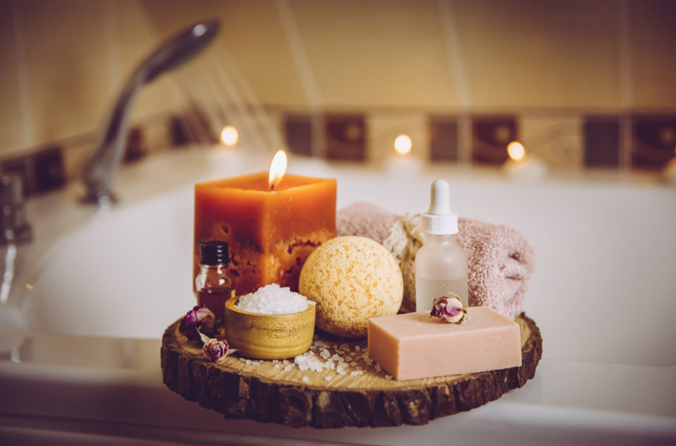 Home spa products on wooden tray