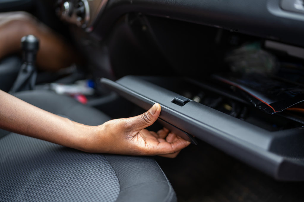 Car Vehicle Registration Papers In Glove Compartment
