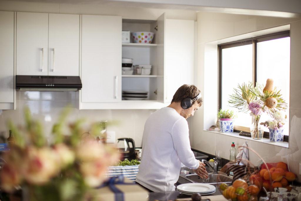 Adult man preparing food in the kitchen.