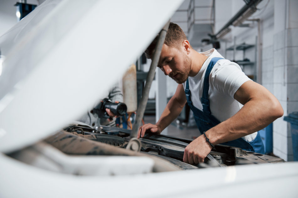auto technician working on a vehicle
